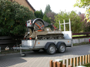 Kettenkrad and trailer loaded on transport trailer